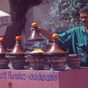 Moroccan street vendor in selling tajines cooking in their conical-lidded tajine pots. Image credit: Andrew Marshall