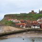 The imposing ruins of the 13th century abbey loom over the old whaling port of Whitby, where narrow cobbled streets and red-bricked houses spill down the slopes of the headland to the natural harbour. IMAGE CREDIT: Paul Marshall