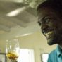 """""""The bartender evaluates  a glass of Mount Gay Extra Old rum  inside the Visitor Centre bar – Image credit Paul  Marshall"""""""