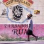 """""""A local walks past a wall advertisement for Old Brigand Barbados Rum – Image credit Andrew Marshall"""""""