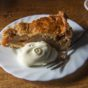 """""""Classic Dutch apple pie (appelgebak) accompanied by a large dollop of whipped cream (slagroom), is an Amsterdam culinary highlight and arguably the best is served at  Café  Papeneiland. Image credit: Paul Marshall"""""""
