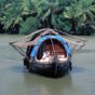 THE-BEST-WAY-TO-EXPERIENCE-THE-BACKWATERS-OF-KERALA-IS-ON-A-KETTUVALLAM-CONVERTED-RICE-BOAT-–-IMAGE-CREDIT-ANDREW-MARSHALL.jpg