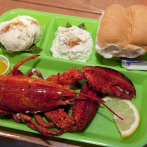 """""""TYPICAL LOBSTER SUPPER ENJOYED ALL OVER THE ISLAND (LOBSTER, PEI POTATO SALAD, AND OVEN-FRESH ROLLS) – IMAGE CREDIT PAUL MARSHALL"""""""